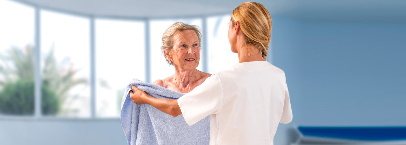 caregiver giving her patient her towel