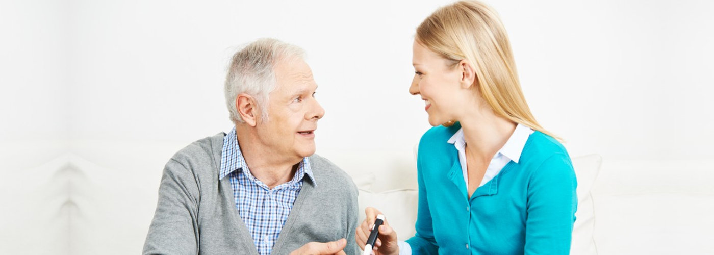 caregiver consulting her patient